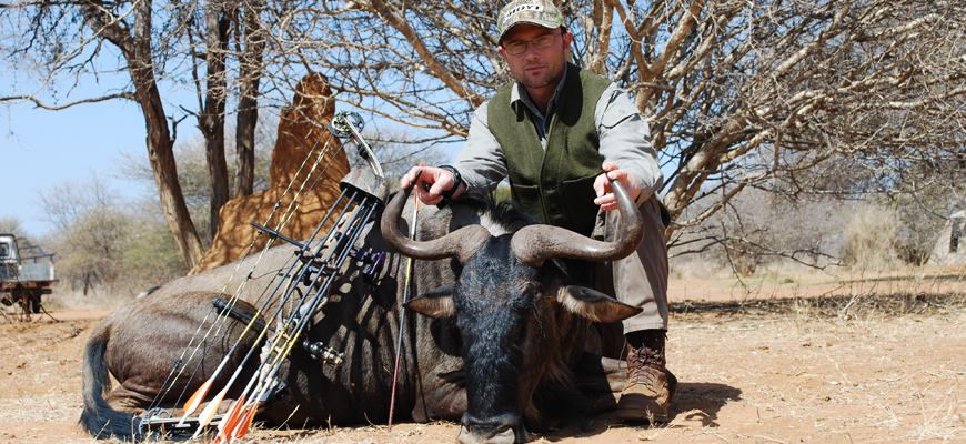 Author Steven M. Kendus with South African blue wildebeest